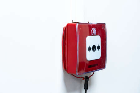 Fire alarm, mounted on the wall in the form of a button Imagens