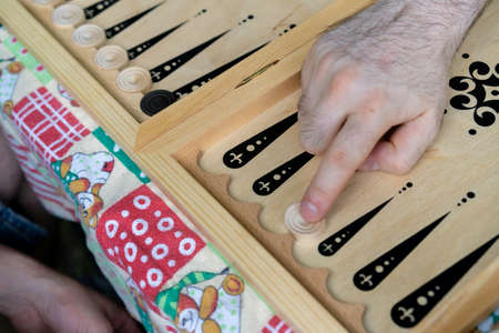 Camping, playing backgammon on the table