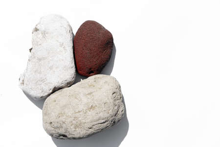 Stones on white background as texture