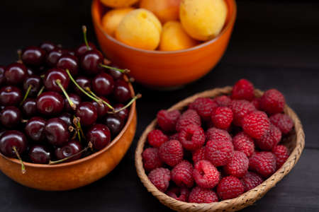 Fruits and berries on a wooden background