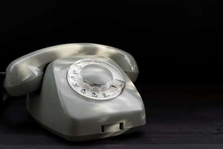 Rotary telephone on black background