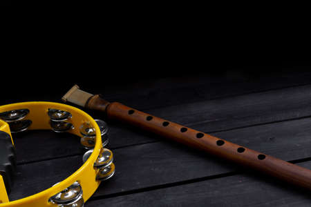 Musical instrument duduk, on a wooden background