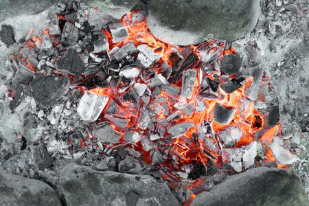 Hot coals from a burning fire Imagens