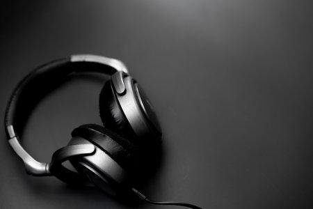 Headphones lie on a black background