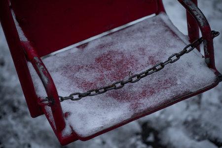 Frozen baby swing in winter