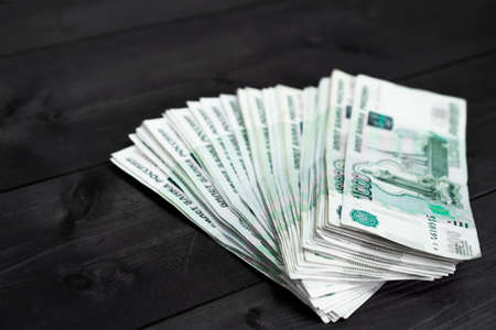 Russian rubles on wooden background