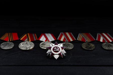 World War II medals on wooden background Imagens