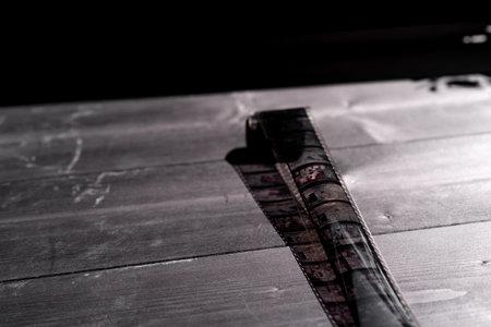 Old film strip on wooden background