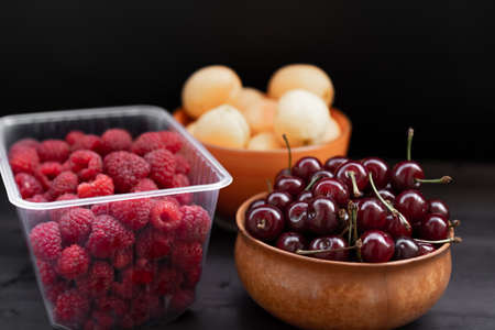 Fruits and berries on a black background