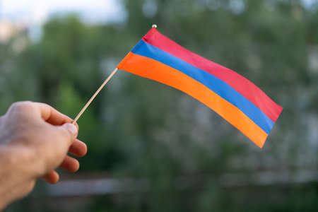 Armenian flag in man's hand