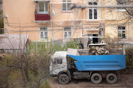 Garbage collection with heavy equipment