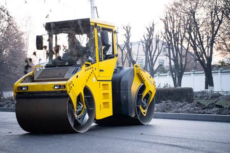 Road repair. Asphalt and concrete roller Banco de Imagens