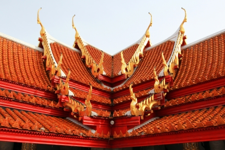 veneration: Multi layered roof with the figure of deity holding two palms to perform veneration Stock Photo
