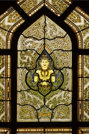 veneration: The figure of deity holding two palms to perform veneration decorated on window of Wat Benchamabophit in Bongkok