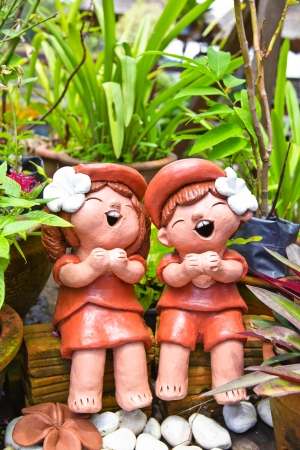 Terra cotta in characteristic of Thai traditional doll photo