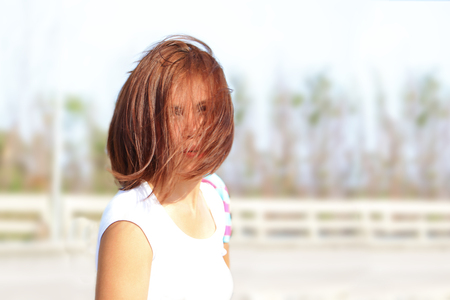 hair cover: Lady with her hairstyle and hair cover her face Stock Photo