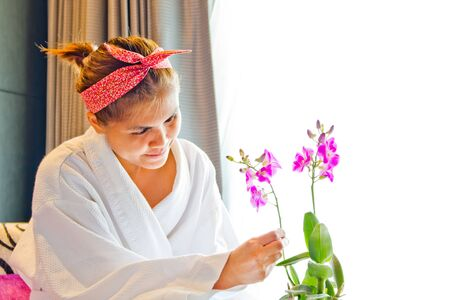 nightgown: Lady wearing nightgown and flower arrangement in the morning
