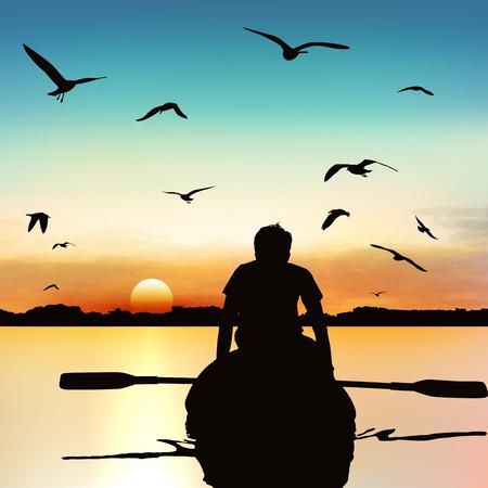 Silhouette of a man kayaking.