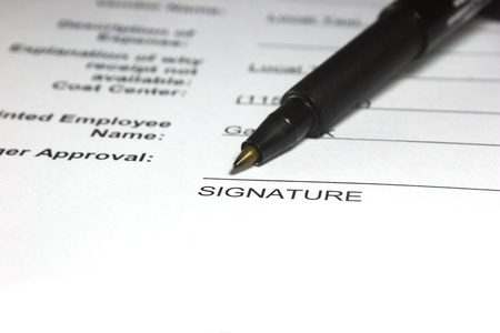 signing authority: Close-up shot of a document with an empty space for signature