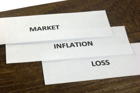Paper cuting with market, inflation and loss on it Stock Photo