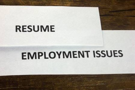 Paper cutting of resume and employment issues photo