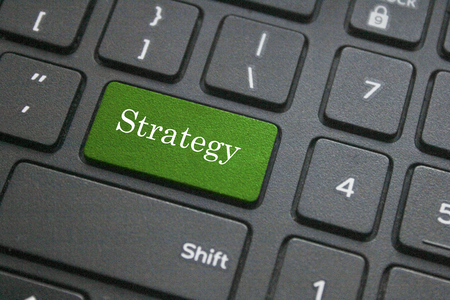 information medium: Close up of strategy button on black computer keyboard Stock Photo