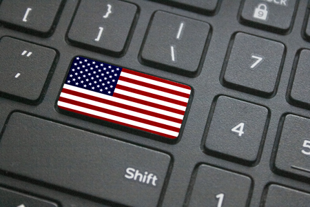 Close up of American flag button on computer keyboard Фото со стока