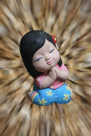 the baked clay doll made in thailand