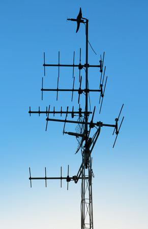 recieve: television antenna on blue sky background