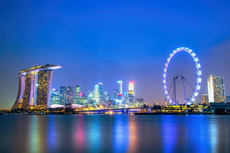merlion: Marina Bay Sands Hotel with Singapore Flyer Editorial