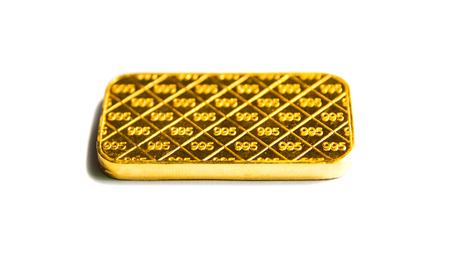 Gold biscuit bar on a white background. Stock Photo