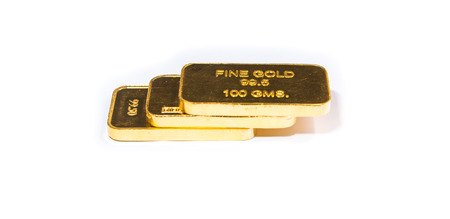 Three gold biscuit bar stacked on a white background