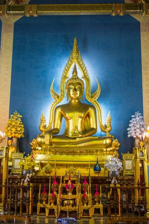 Golden Buddha statue in the Marble Temple or Wat Benchamabophit temple, Bangkok Thailand Editorial