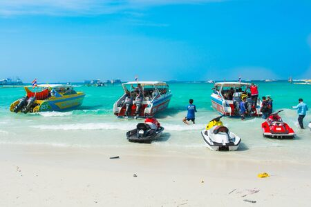 Speedboats, jetski and  tourist at beach Editorial