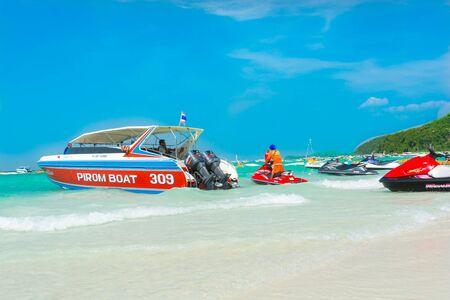 speedboats: Speedboats, jetski and  tourist at beach Editorial