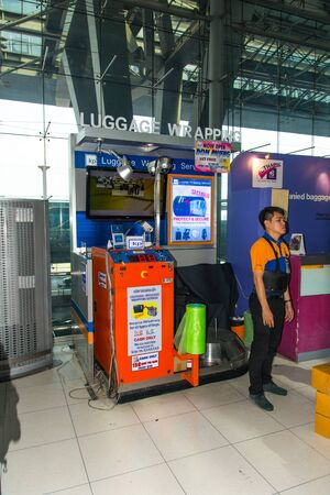 Luggage wrapping service at the airport Editorial