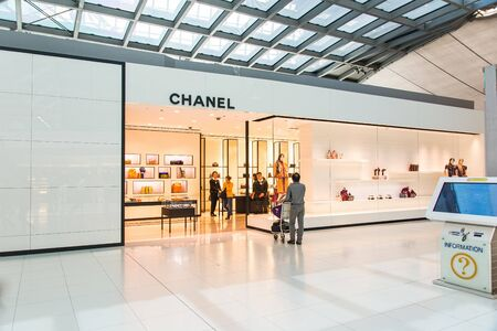 chanel: Passenger looking curiously at Chanel Showroom at the airport