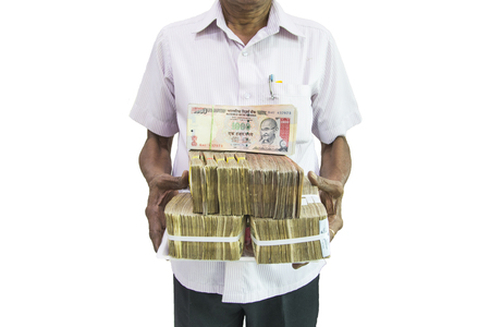 Man holding Indian currency notes on white  background Stock Photo