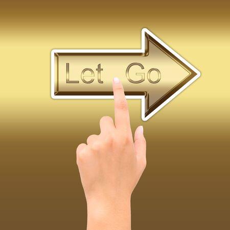 satined: hand point golden arrow symbol letgo Stock Photo