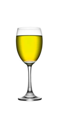 yellow in wineglass  on a white isolate background