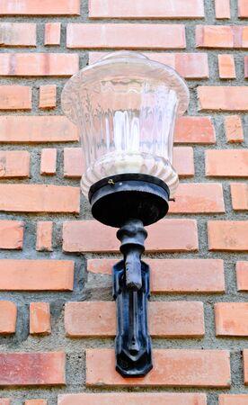 lamp on a  brickwall