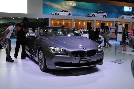 bronz: NONTHABURI, THAILAND - MARCH 30: The BMW 640i Convertible in the 32nd Bangkok International Motor Show on March 30, 2011 in Nonthaburi, Thailand. Editorial