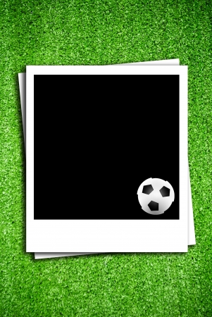 Photoframe with soccer  ball on artificial grass field texture photo
