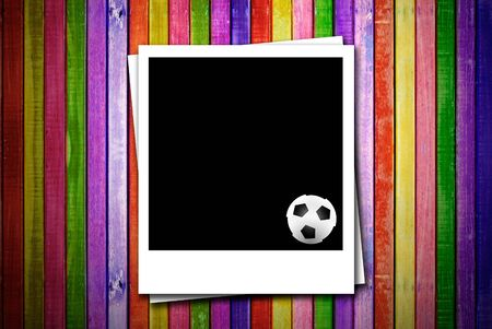 Photoframe with soccer ball on colorful empty wood advertisement photo