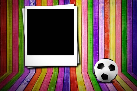 Photoframe and soccer ball on colorful empty wood advertisement photo