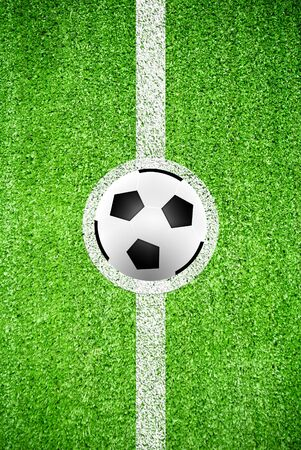 Soccer ball on a line of artificial grass field texture photo