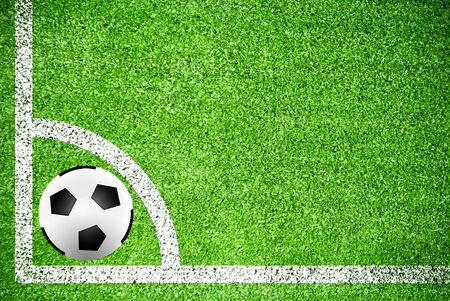 Soccer ball on artificial grass field texture photo
