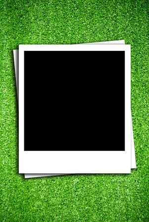 Photo frame on artificial grass field texture Stock Photo - 13794313