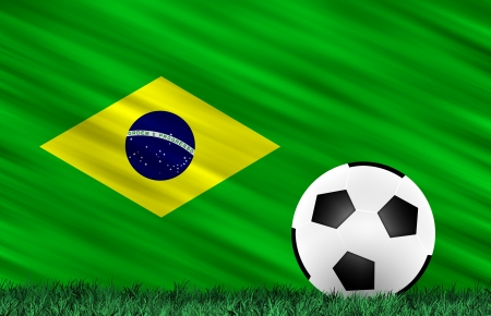 Soccer ball on grass field and  Brazil flag photo