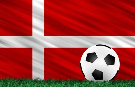 Soccer ball on grass field and  Denmark  flag photo